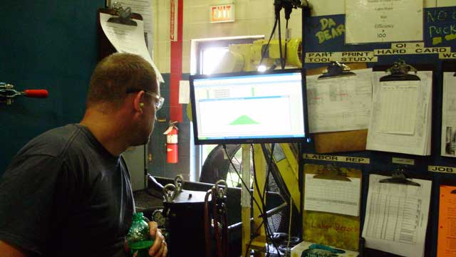 A photo of an operator at United Gear & Assembly using Synergy 2000 SPC Software.